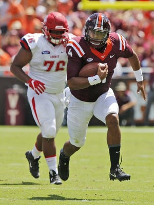 Virginia Tech quarterback Jerod Evans breaks away for a big gain during against Liberty on Sept. 3, in Blacksburg, Va.