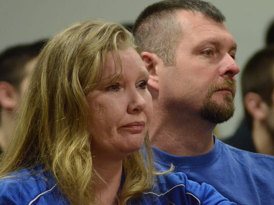 Jennifer Madden, with Jason Kasten, listens to the plea in the death of her son.