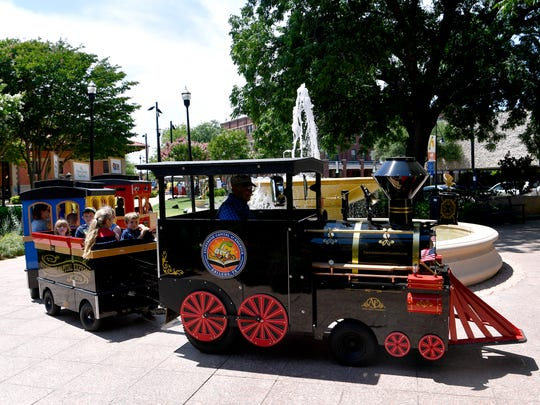 Families ride the Storybook Capital Express through Everman Park at last year's Children's Art & Literacy Festival.