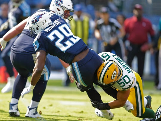 Green Bay Packers linebacker Blake Martinez (50) tackles Tennessee Titans running back DeMarco Murray (29) in the first half at Nissan Stadium in Nashville, Tenn.