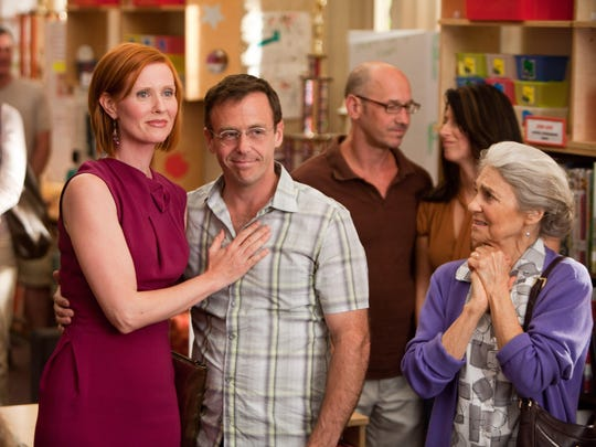 "(L-R) Cynthia Nixon as Miranda Hobbes, David Eigenberg as Steve Brady and Lynn Cohen as Magda in New Line Cinema's comedy ""Sex and the City 2,"" a Warner Bros. Pictures release."