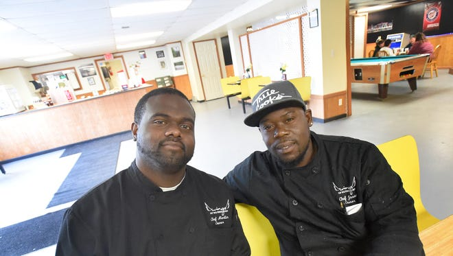 Roderick Martin and Jason Lewis work together as co-owners the restaurant, Wings of Waynesboro.