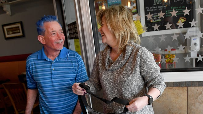 Rhonda Carden  jokes about her fanny pack with co-worker Marty Saxberg during lunch hour at Sons of Sicily in Shrewsbury. Carden is hoping to raise money for Saxberg, who works with her at Giant in Shrewsbury, and was recently diagnosed with colon cancer.