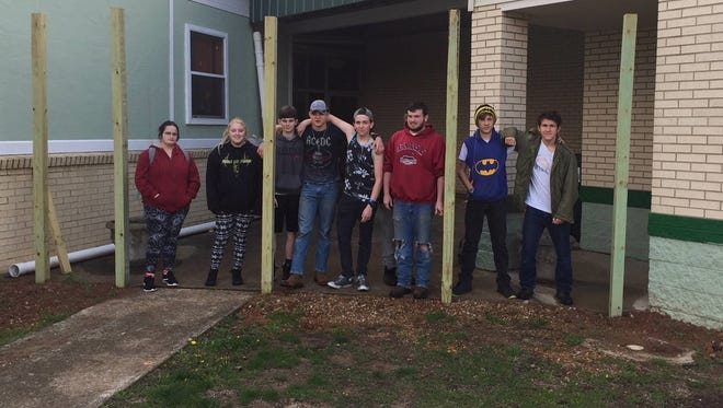 Students from Yellville-Summit's RISE Academy constructed this fence over at the elementary school earlier this year. Pictured are (from left) Melody Long, Jaden Parnell, Bryce Lingo, Xavier Robinson, Justin Grinder, Joshua Coker, Eric White and Derrick Bechtel.