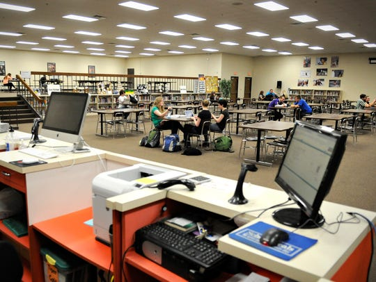 Students use the library and resource center May 7