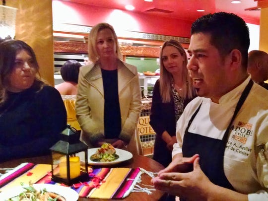 Marco Aguilar, chef at Adobe Grill, addresses members of the media during a recent tasting.