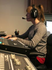 Breanna Speth, assistant coordinator for Marshfield Community TV, operates a switchboard in the control room during a broadcast on February 3, 2016.