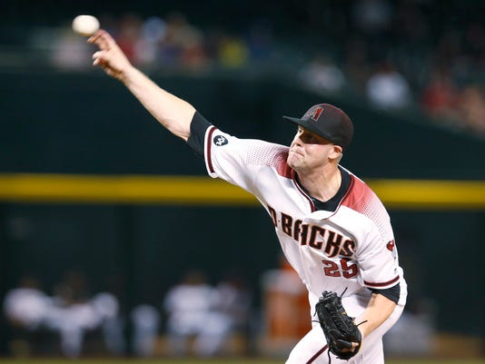 Arizona Diamondbacks pitcher Archie Bradley throws in the first inning during a baseball game against the Washington Nationals, Monday, Aug. 1, 2016, in Phoenix. (AP Photo/Rick Scuteri)