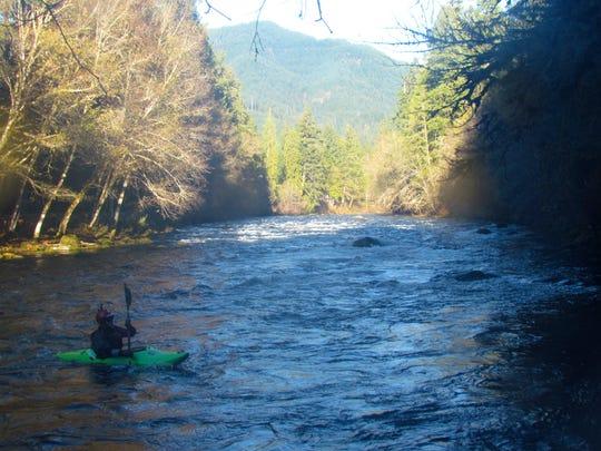 Chris Watson kayaks down the Mckenzie River.