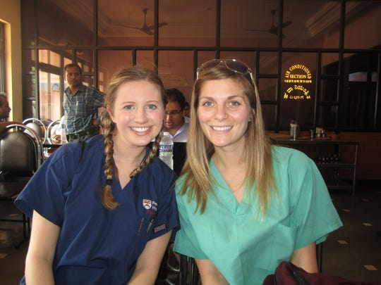 Nurses Kelli Glenn and Dani Schnapf were among the volunteers who paid their own way.