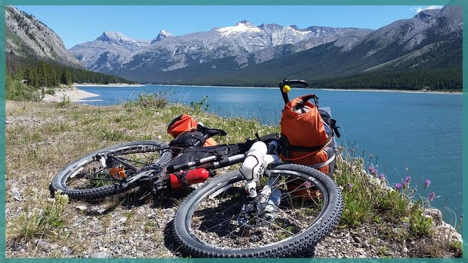 Angela Wolz wants to inspire more people to travel. She works two full-time jobs during season, as a waitress and at a bike shop, to take long adventure trips.
