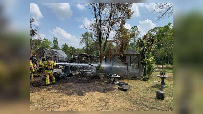 Palm Beach County Fire Rescue crews extinguish a shed fire behind a home in Loxahatchee Groves on Wednesday April 15, 2020.
