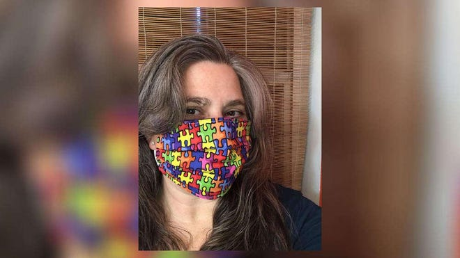 Softball mom Victoria Lindsay is making face masks to combat the spread of the coronavirus. Using jigsaw puzzle-printed cloth and elastics, Lindsay also is raising awareness for those on the autism spectrum.