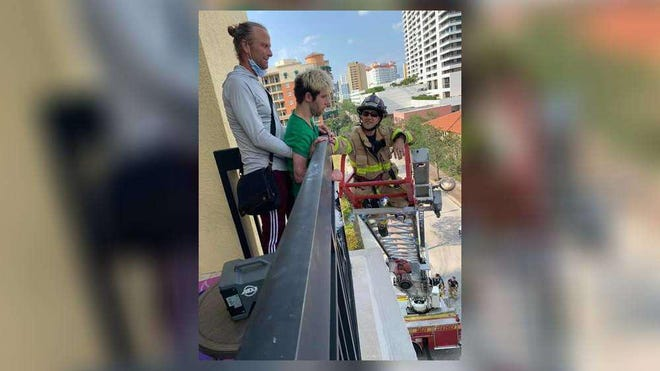 Korey Soderman and his family is surprised by Lieutenant Brett Koning and his fellow firefighters after five fire trucks pull up along their street and Koning climbs the ladder to greet him on the balcony of his family's apartment.