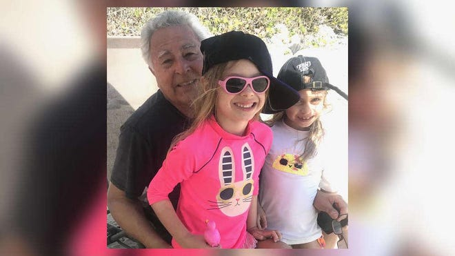 Tom Craciun with his 6-year-old twin granddaughters, Hunter (in pink) and Addi, during a visit to his South Palm Beach condo the second week of March, about a week before he fell ill with coronavirus. He died April 1.
