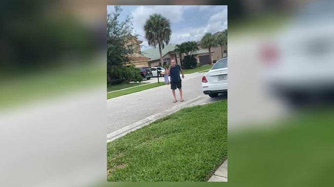 In this image taken from video, a man is seen yelling at three girls in the Grand Isles neighborhood of Wellington. The man has been identified as Lee Jeffers, 60, an employee for the U.S. Citizenship and Immigration Services.