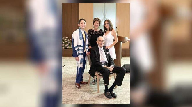 Robin and Michael Lamkay with their grandchildren, Max and Mollie Weinstein, at Max's bar mitzvah in January. The Lamkays later contracted Covid-19.
