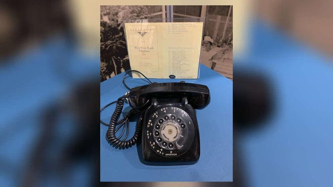 A rotary phone and an old phone book on display as part of the Palm Beach County History Museum's West Palm Beach exhibit. The county's first telephone area code had stood for 41 years.