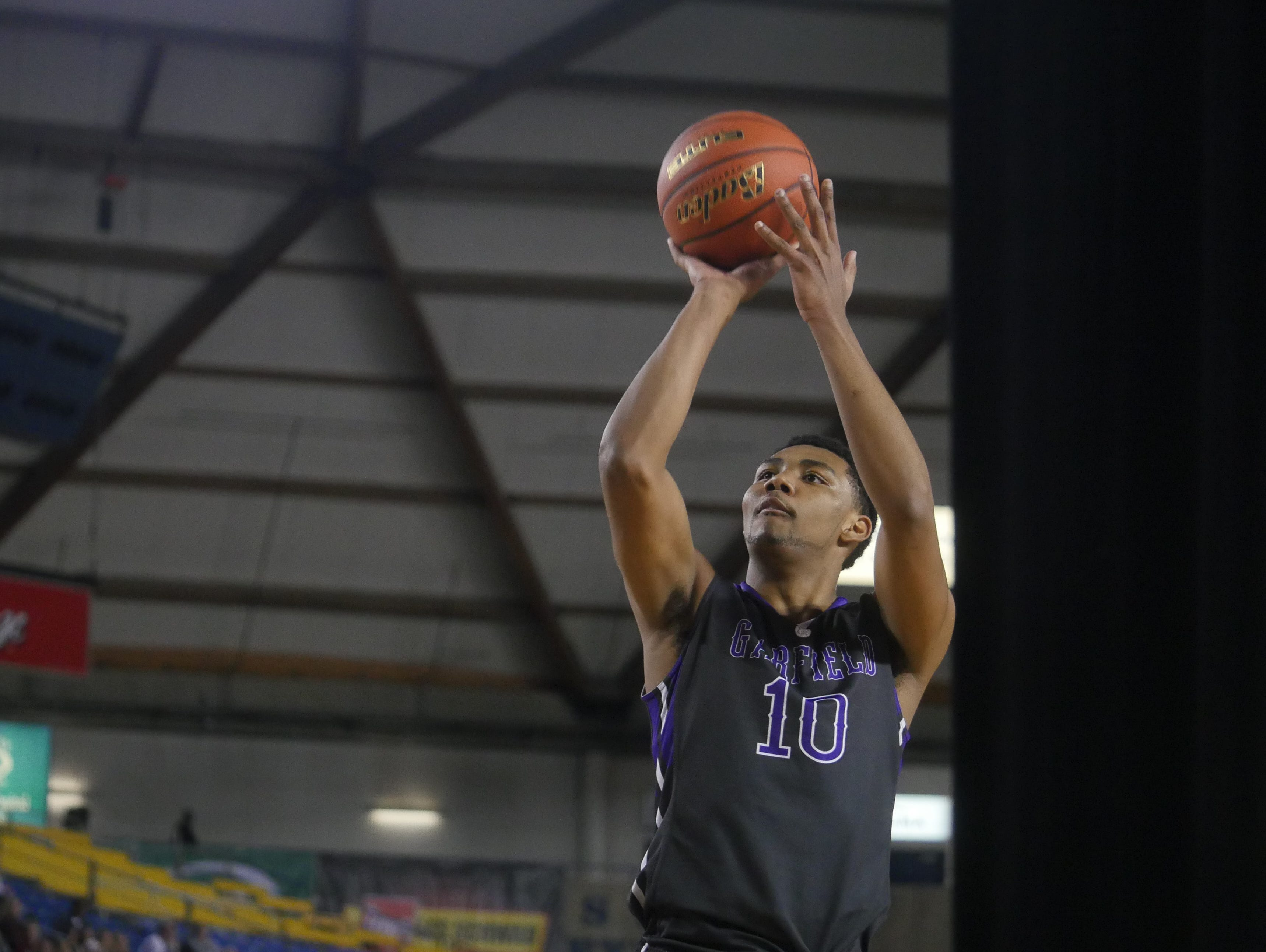 Garfield wing Alfonso Anderson at the free-throw line during the 2014 state basketball tournament.