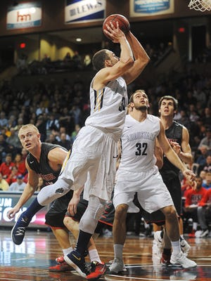 Augustana's Alex Richter (31) goes up for a shot during the NSIC men's basketball tournament championship game against Minnesota State Moorhead Tuesday, March 1, 2016, at the Sanford Pentagon in Sioux Falls.