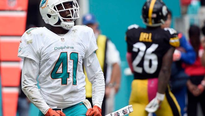 Miami Dolphins cornerback Byron Maxwell (41) celebrates during the second half of Sunday's 30-15 win against the Pittsburgh Steelers in Miami.