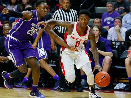 Rutgers guard Nigel Johnson (0) drives to the basket against Northwestern Wildcats guard Scottie Lindsey (20)