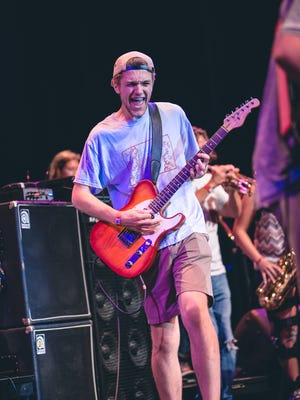 Will Leach performs with his band Skunkifunkmonki at the 2015 School of Rock final concert.