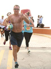 Bill Amirault running in the Key West, Florida, Half Marathon a few miles before collapsing.