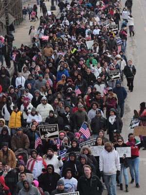 "Hundreds of people march along W. Vernor Highway. in Detroit during the ""A Day Without Immigrants"" rally Feb. 16, 2017."