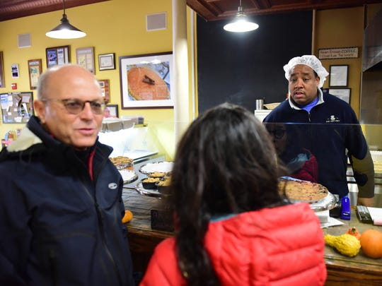 Tod Wilson talks to customers at Mr. Tod Pie Facotry in Englewood.