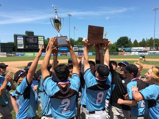 The South Burlington Wolves celebrate with the championship trophies after their 5-3 win over Colchester in the Division I state championship game on Saturday at Centennial Field.
