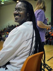 McNiel Middle School coach Russell Henry has grown his dreadlocks to about 34 inches over the last 13 years and allowed students and teachers to cut the locks for $10 per braid Friday to raise money for a bench. The bench will be in memory of slain McNiel student Lauren Landavazo, who was killed in September 2016.