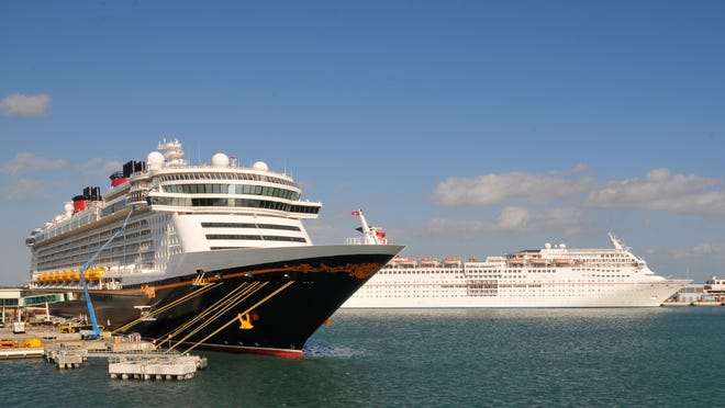 The Disney Dream, at left, on Friday replaced a port-of-call visit to Nassau, the Bahamas, with a day at sea because of Hurricane Joaquin.