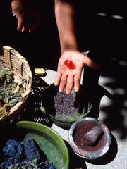 Cochineal crushed to powder is mixed with water to