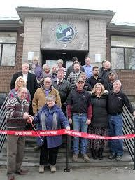 Representatives of Hillsdale County pose for a picture during the ribbon cutting of the County Offices Building on McCollum Street in December 2018.