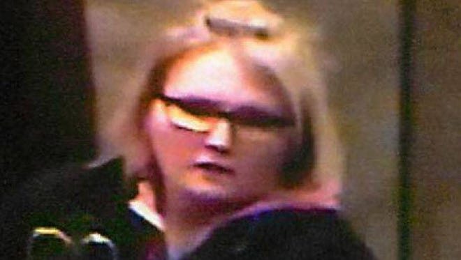 Police want to identify this woman, pictured here in a still shot from a surveillance camera. Anyone with information can call Detective Aaron Ruber at 734-466-2325.
