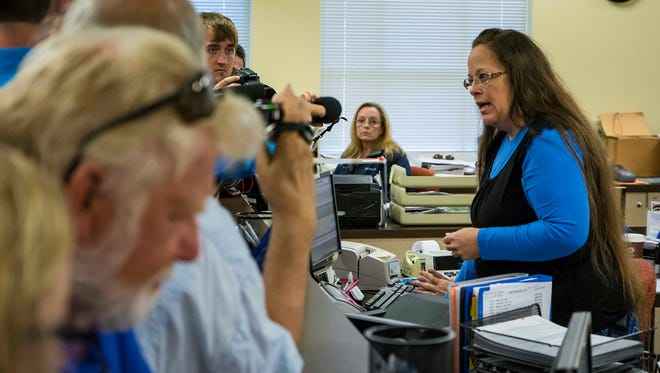 Rowan County (Ky.) Clerk Kim Davis, right, argues with David Moore and David Ernold, after they were denied a marriage license at the Rowan County Courthouse in Morehead, Ky., on Tuesday, Sept. 1, 2015.
