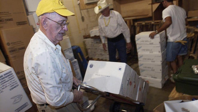 In this 2005 file photo, Charles Willoughby, then an 80-year-old retiree, helps move cans of food from a storage building at the Louisiana Baptist Convention in Alexandria to an awaiting truck as part of a group of volunteers who traveled to Covington, La., to help with Hurricane Katrina disaster relief. He has now retired to the Mississippi State Home for Veterans.