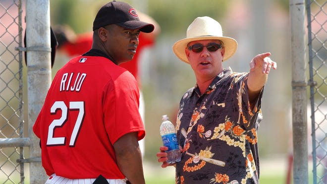 The Cincinnati Reds' general manager Jim Bowden, right has a conversation with Jose Rijo, left, on Thursday, Feb. 20, 2003, during Spring Training workouts in Sarasota, Florida.