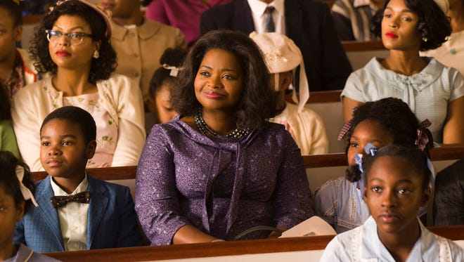 """This image released by Twentieth Century Fox shows Taraji P. Henson, background left, Octavia Spencer, center, and Janelle Monae, background right, in a scene from """"Hidden Figures."""""""
