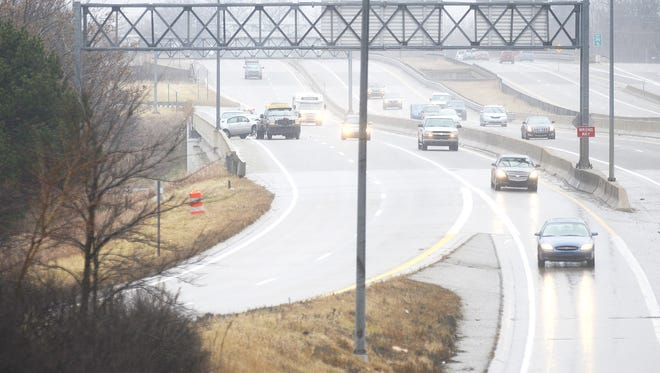A crash on Interstate 496 Westbound at the Grand Avenue exit is one of many crashes due to icy roads tying up traffic across the area today, Thursday, December 18, 2014.