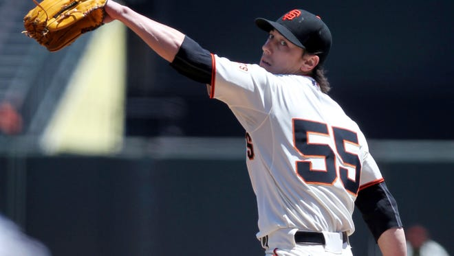 Giants starting pitcher Tim Lincecum throws to the Cubs in the first inning of their baseball game at AT&T Park.