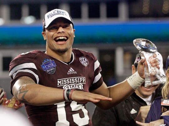 Mississippi State quarterback Dak Prescott (15) celebrates