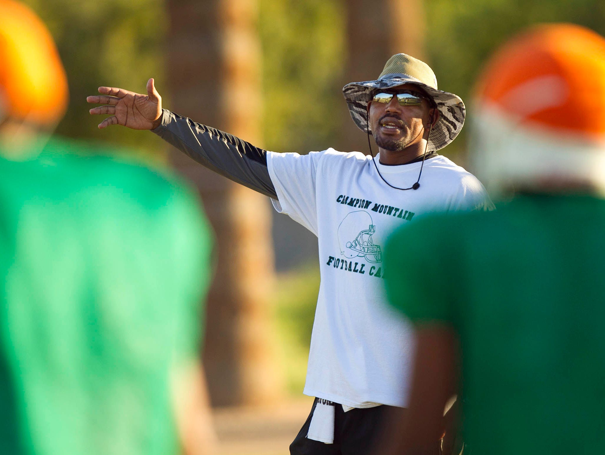 Todd Williamson puts the St. Mary'??s football team through practice on Monday, Oct. 1, 2012 in Phoenix.
