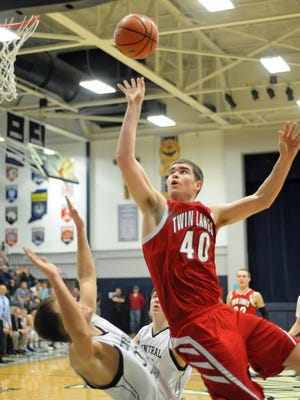 Indian Senior Dane Holmes drives to the basket as Twin Lakes beat Central Catholic in double overtime Thursday night.
