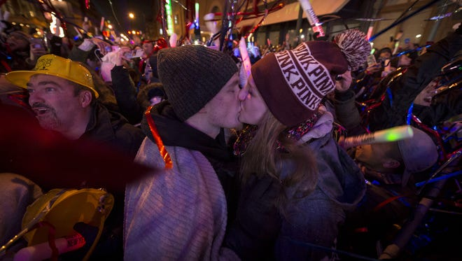 Mason West and Heather Fields, both of Lebanon, share a New Year's kiss at Downtown Indy Inc.'s New Year's Eve event on Jan. 1, 2018.