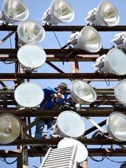 Jamie Mounts of Evansville repairs a light fixture