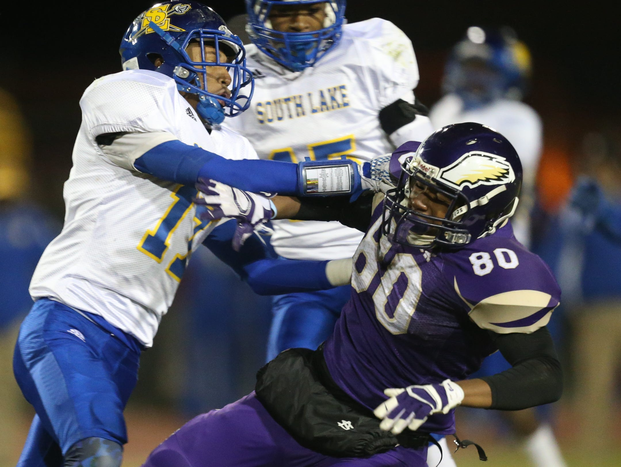 Madison Heights Madison high schools Bacari Marino is hit by South Lake high schools Anthony Morgan during first half action Friday, October 16, 2015 in Madison Heights Michigan.