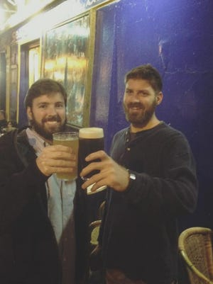 Taylor Force, left, with his friend Barrett Caldwell during a trip to Ireland.