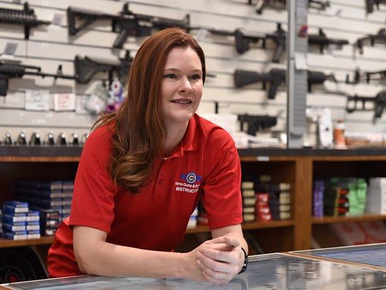 Alisha Ketter leans behind the counter at Reno Guns